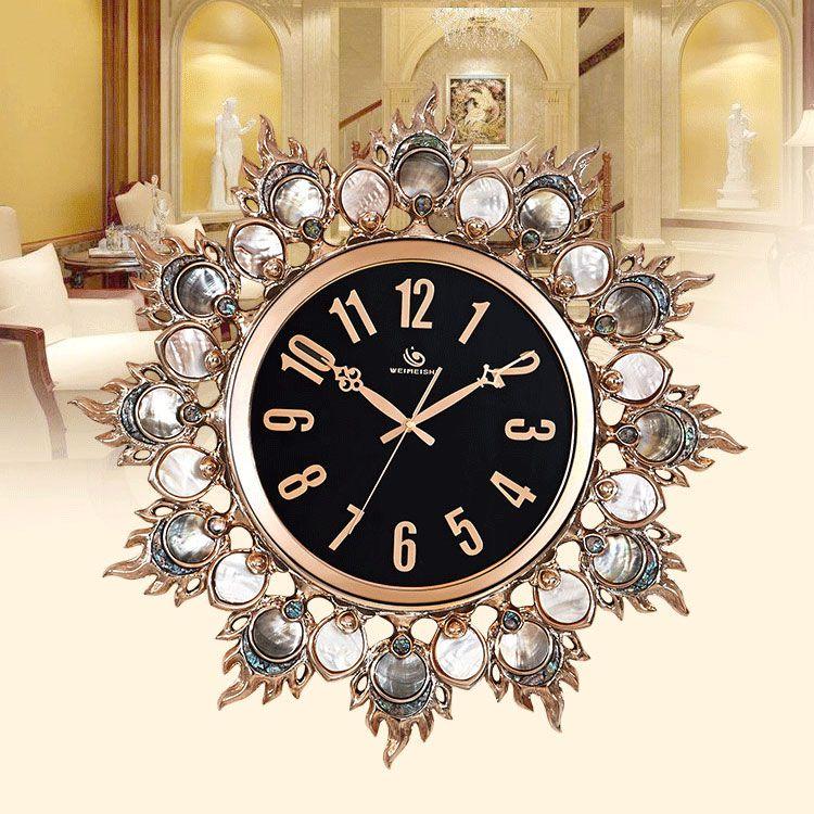 Đồng hồ treo tường cao cấp xứng tâm tỏa sáng PY121